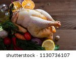 one raw prepared chicken with... | Shutterstock . vector #1130736107