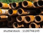 oil drill pipe. rusty drill... | Shutterstock . vector #1130746145