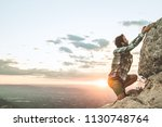 climber climbing a rock in the... | Shutterstock . vector #1130748764