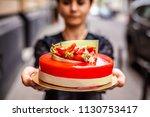 the girl on the street in her... | Shutterstock . vector #1130753417
