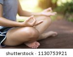 woman practices yoga and... | Shutterstock . vector #1130753921