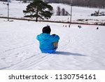 a child playing a sled at a ski ... | Shutterstock . vector #1130754161