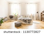 front view of a simple bedroom... | Shutterstock . vector #1130772827