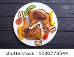 grilled chicken legs with... | Shutterstock . vector #1130773544