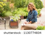 beautiful woman sittinh in the... | Shutterstock . vector #1130774834