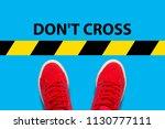 female feet in red sneakers... | Shutterstock . vector #1130777111