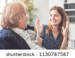 young daughter talking with her ...   Shutterstock . vector #1130787587