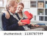 young daughter gives her father ... | Shutterstock . vector #1130787599
