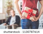 young daughter gives her father ...   Shutterstock . vector #1130787614
