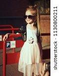 lifestyle portrait of stylish... | Shutterstock . vector #1130800211