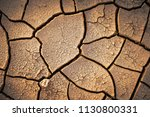 dried cracked earth soil ground ... | Shutterstock . vector #1130800331