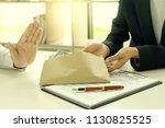 business man give bribe to the...   Shutterstock . vector #1130825525