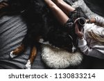 Stock photo beautiful girl lying and her cute dog bernese mountain dog on bed stylish fashionable cozy a 1130833214