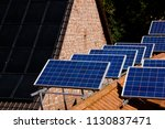 black  dark solar panels on... | Shutterstock . vector #1130837471