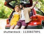boyfriend pointing on something ... | Shutterstock . vector #1130837891