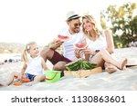 happy family is enjoying beach...   Shutterstock . vector #1130863601