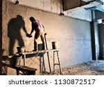 workers are plastering the... | Shutterstock . vector #1130872517