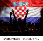 football supporters with raised ... | Shutterstock . vector #1130876717