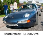 GRANTOWN ON SPEY, SCOTLAND - SEPTEMBER 2: Porsche 928 on display in the annual Motor Mania car show on September 2, 2012 in Grantown On Spey, Scotland - stock photo
