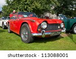 GRANTOWN ON SPEY, SCOTLAND - SEPTEMBER 2: Triumph TR5 on display in the annual Motor Mania car show on September 2, 2012 in Grantown On Spey, Scotland - stock photo