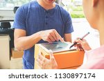 delivery service courier driver ... | Shutterstock . vector #1130897174