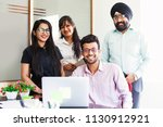 indian team of four people... | Shutterstock . vector #1130912921