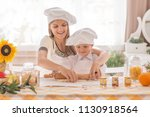 happy mom with a child rolling...   Shutterstock . vector #1130918564