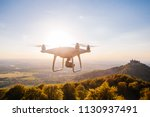 copter drone flying at sunset... | Shutterstock . vector #1130937491