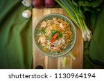 pad thai  thai noodles with... | Shutterstock . vector #1130964194