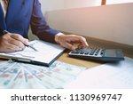 businessman analyzing... | Shutterstock . vector #1130969747