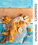 two pieces of fried fish in... | Shutterstock . vector #1130989835