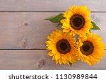 summer sunflowers on a wooden...   Shutterstock . vector #1130989844