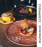 fresh berry tart served with... | Shutterstock . vector #1130994311