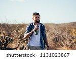man taking a break to drink...   Shutterstock . vector #1131023867