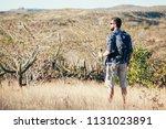 man taking a break to drink...   Shutterstock . vector #1131023891