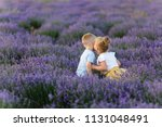playful little cute couple boy... | Shutterstock . vector #1131048491