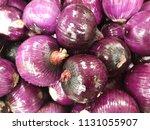 purple onion for sale in market. | Shutterstock . vector #1131055907