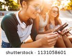 image of young happy three... | Shutterstock . vector #1131058601
