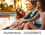three smiling young girls... | Shutterstock . vector #1131058631