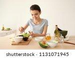 young woman making nourishing... | Shutterstock . vector #1131071945