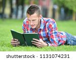 young student man with laptop... | Shutterstock . vector #1131074231