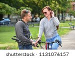 young couple flirting on... | Shutterstock . vector #1131076157