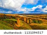autumn river valley village... | Shutterstock . vector #1131094517