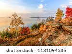 autumn trees on mountain lake... | Shutterstock . vector #1131094535