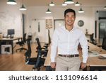 smiling young asian businessman ... | Shutterstock . vector #1131096614
