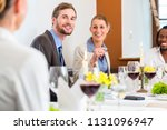 team having business lunch in... | Shutterstock . vector #1131096947