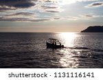 lonely boat in the sunset  | Shutterstock . vector #1131116141