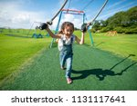 girl playing in the park | Shutterstock . vector #1131117641