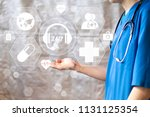 doctor pushing button 24 hours... | Shutterstock . vector #1131125354