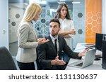 business office workers arguing ...   Shutterstock . vector #1131130637